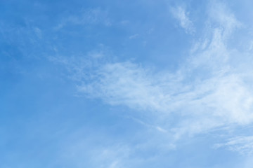 Blue sky with clouds background lines intersect.