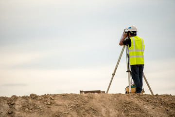survey engineer in construction site use theodolite mark a concrete pile co ordinate