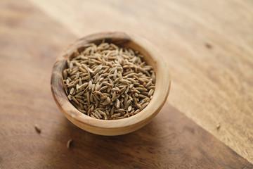 cumin zira seeds in wood bowl on table