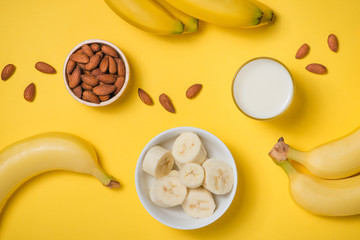 Fresh banana with milk and almonds.