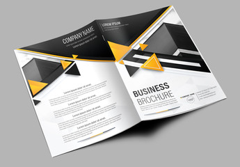 Brochure Cover Layout with Black and Orange Accents