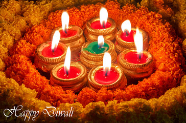 Diwali festival decorations with traditional diya clay lamps and marigold flowers.