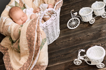 Baby sleeping in the basket. Tricycle flower baskets.