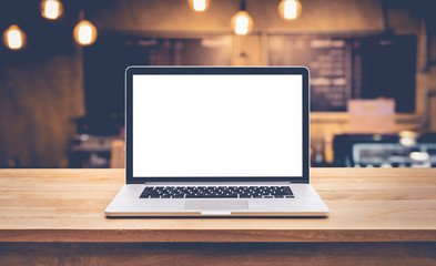 Modern computer,laptop with blank screen on table with blur cafe,restaurant background