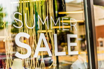 Closeup of Summer Sale sign on store window
