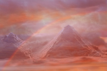 Another world. Mountain peaks, a rainbow and incredible colors