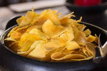 Manioc Chips into a bowl