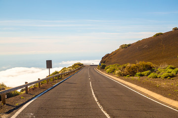 Beautiful road above the clouds to Teide volcano on Tenerife island