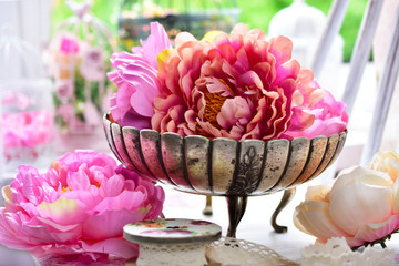 peony flowers in antique silver bowl