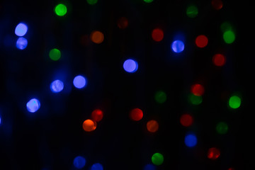Colorful bokeh on black background.