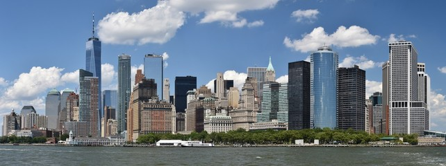 The Freedom Tower, Wall Street, and the skyline of downtown Manhattan from New York Harbor.