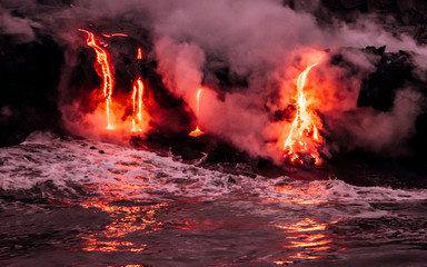 Lava is flowing from volcano Kīlauea to Pacific ocean at night