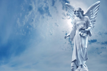 Guardian Angel sculpture over bright sky Wall mural