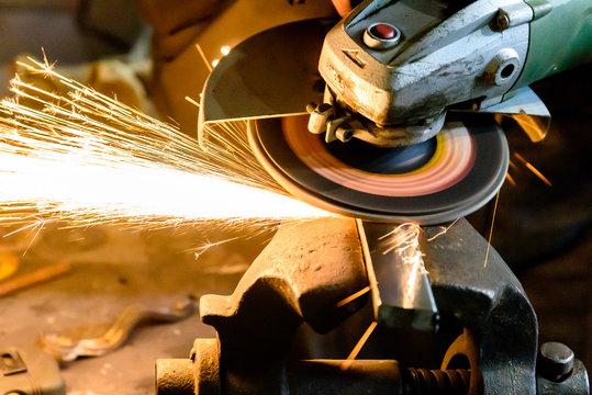 Cutting metal grinding machine, spark.
