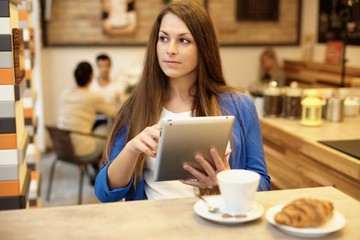Attractive girl using tablet