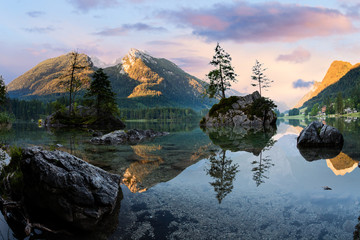 Hintersee alpine mountain lake and clousy colorful sunrise