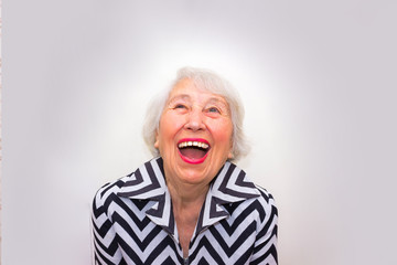 The portrait of a laughing old woman