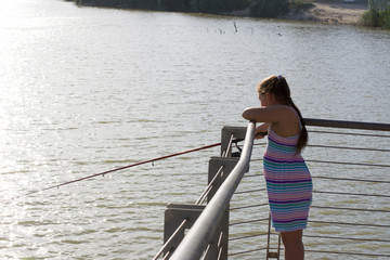 a little girl spends some time fishing
