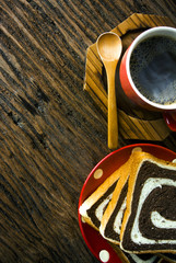 red coffee cup with wood spoon with bread