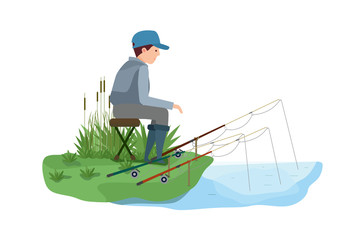 Fisherman, with few fishing rods, sitting on shore of lake.