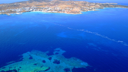Aerial drone photo of Koufonisi island with clear turquoise waters, Cyclades, Greece