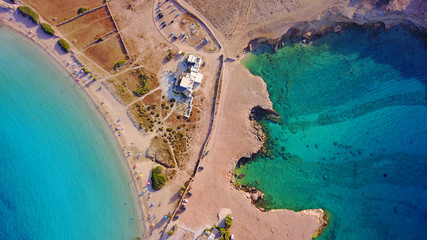 Aerial drone photo of famous caves of Ksylobatis near Pori beach, Koufonissi island. Cyclades, Greece