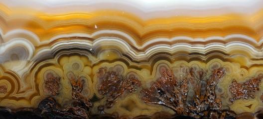 A polished and banded Agate crystal specimen