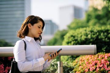 business woman using smart phone.