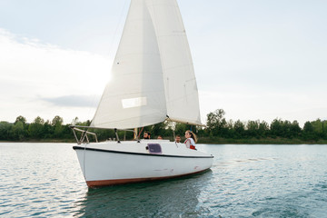 Group of people on sailing boat on lake, Signa, Tuscany, Italy