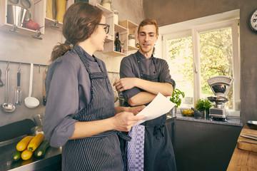 Chefs in kitchen chatting