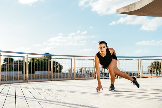 Young woman exercising outdoors, South Point Park, Miami Beach, Florida, USA