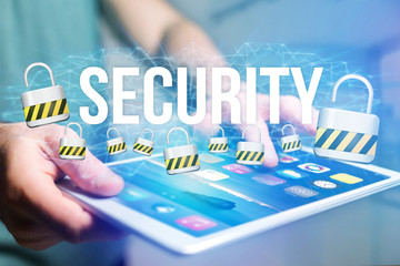 Concept of man holding interactive interface with security title and multimedia padlock icons flying all around - Internet concept