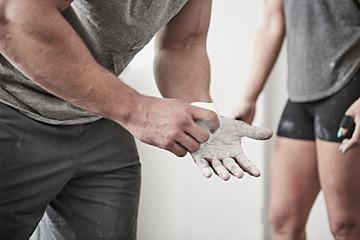 Man chalking hand