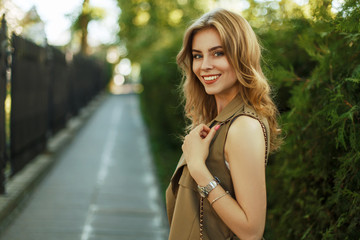 Happy young woman with a smile walking in the park