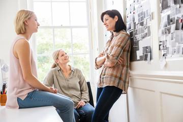 Female coworkers talking