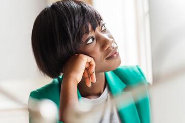 Female designer gazing in creative studio