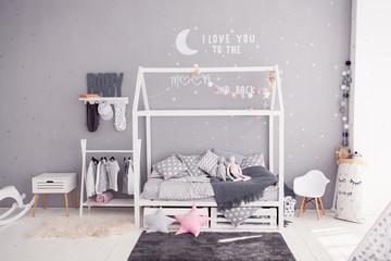 Cozy children's bedroom in scandinavian style with diy accessories