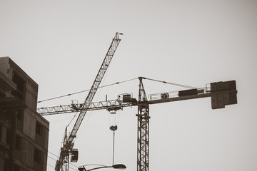 Black and white shot of a construction lifting crane