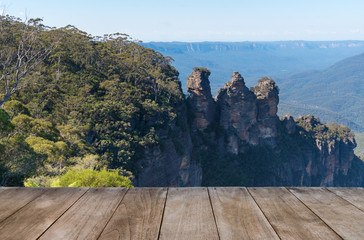 Empty wooden table in front of Jamison Valley and Three Sisters rock formation in Katoomba, Australia