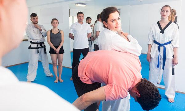 Woman trainer shows defense methods