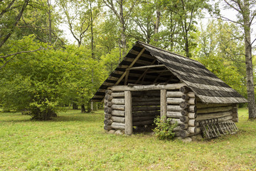 A wooden shed in wooded meadows (Nadrema, Estonia)