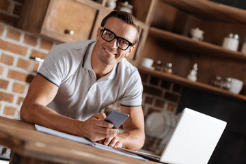 Energetic enterprising man receiving a message from employer