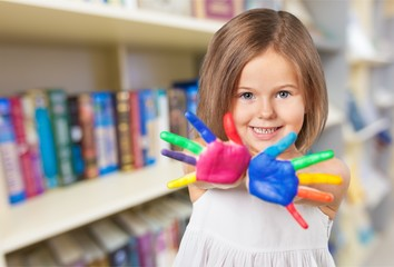 Child showing colorful hand.