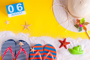 August 6th. Image of august 6 calendar with summer beach accessories and traveler outfit on background. Summer day, Vacation concept