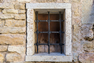 Castle barred window. Medieval style window dirty