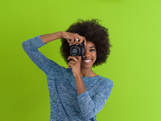 black girl taking photo on a retro camera