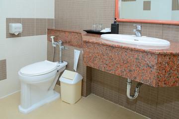 Toilet seat decoration in bathroom interior