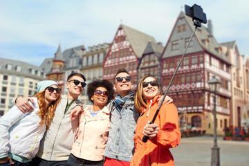 friends taking photo by selfie stick in frankfurt