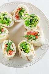 Tortilla with salmon, cheese and vegetables for a lunch