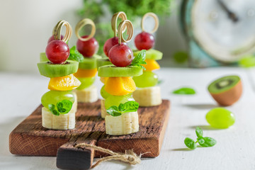 Papiers peints Entree Closeup of homemade snacks with various fruits and mint